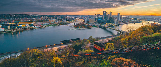 A photo of a sunrise over Pittsburgh. Photo | Dave DiCello