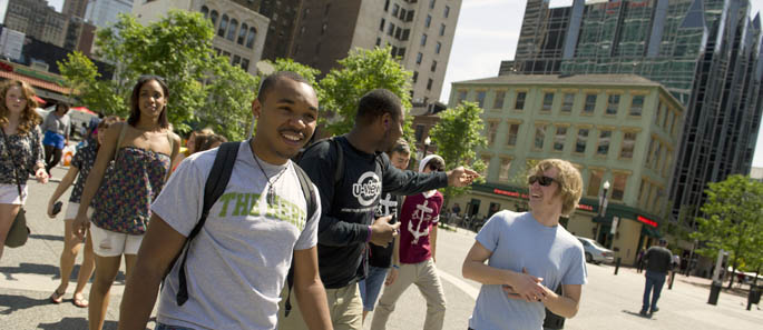 Pictured are Point Park undergraduate students in Market Square, Downtown Pittsburgh.