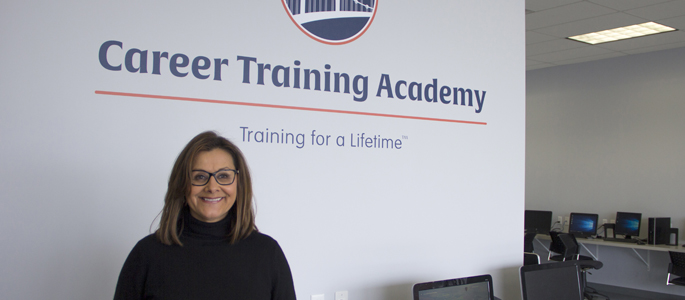 Pictured is Kimberly Rassau, M.A. in curriculum and instruction graduate and president and CEO of Career Training Academy. | Photo by Shayna Mendez