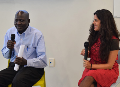 Pictured is Sudanese refugee and School of Business alumnus Panther Bior with Helena Knorr, Ph.D., associate professor of organizational leadership at Point Park. | Photo by Gracey Evans