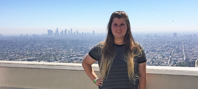 Pictured is SAEM student Cassandra Crisp in front of the Los Angeles skyline. | Photo by Angela Thomas