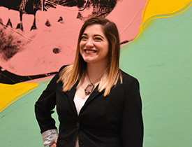 Pictured is SAEM alumna and M.B.A. student Lena Tavoletti, administrative and financial coordinator for The Andy Warhol Museum. | Photo by Brandy Richey