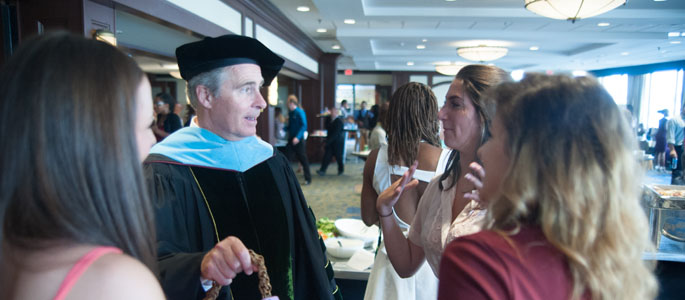 Pictured is President Paul Hennigan with Point Park students at the reception following the Convocation ceremony at Sheraton Station Square on Aug. 22, 2014. | Photo by Chris Rolinson