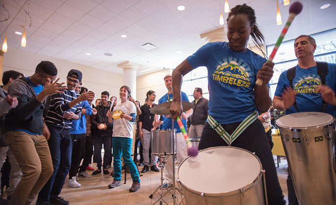 Drummers from Timbeleza, a Brazilian drum band, perform in Lawrence Hall as Point Park students move to music at the annual Global Festival Celebration March 19. | Photo by Christopher Squier