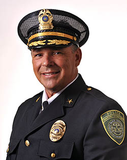 Head shot of Chief of University Police Jeffrey D. Besong in uniform.