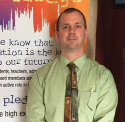 Pictured is Scott Manns, elementary education alumnus and K-12 curriculum, instruction and assessment coordinator for Pittsburgh Public Schools. | Photo by Amy Manns
