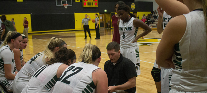 Pictured is head coach Tony Grenek with the Point Park women's basketball team. | Photo by Chris Squier