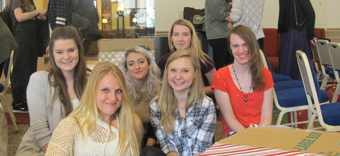 Pictured are students at the Confluence Psychology Alliance's 2015 Blanket/Coat Kick-Off Party. | Photo by Amanda Dabbs
