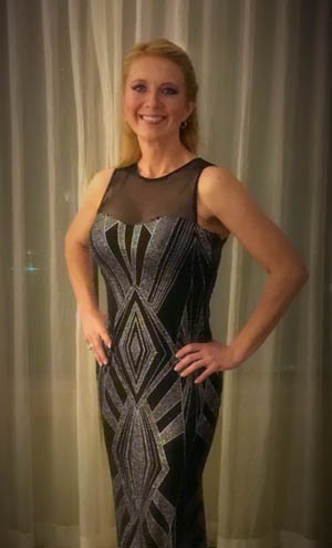 Pictured is Michele Langbein, Ph.D., modeling at Inspiring Lives International Gala.