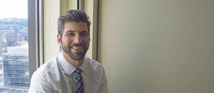 Pictured is Benjamin Eonta, M.B.A. graduate and lead operations analyst for UPMC Health Plan. | Photo by Shayna Mendez
