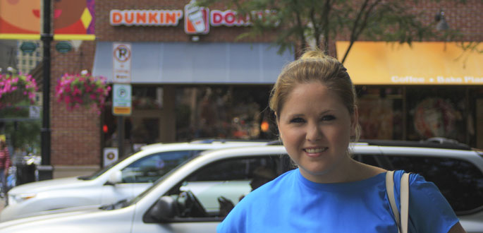 Pictured is business management alumna Chelsea Halker, Marketing and Guest Services Manager for Dunkin' Donuts. | Photo by Tanner Knapp