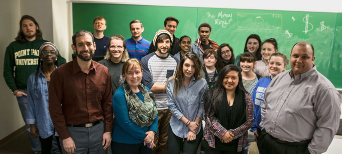 Pictured are Point Park faculty members Angela Isaac, Joseph DeFazio and David Diehl with students in The Money Thing course. | Photo by Daniel Kelly