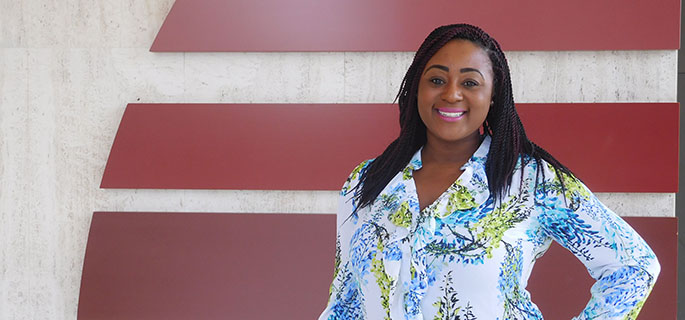Pictured is M.B.A. alumna Patriece Thompson, investor relations manager for the Allegheny Conference on Community Development. | Photo by Brittany Bishop