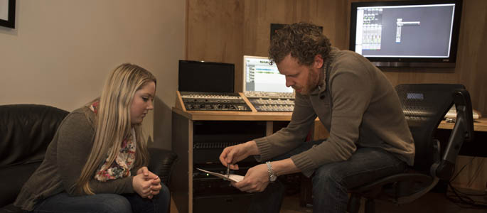 Pictured is Point Park SAEM student and musician Hannah Jenkins with Jesse Naus, owner and head engineer of Red Caiman Studios in Pittsburgh.
