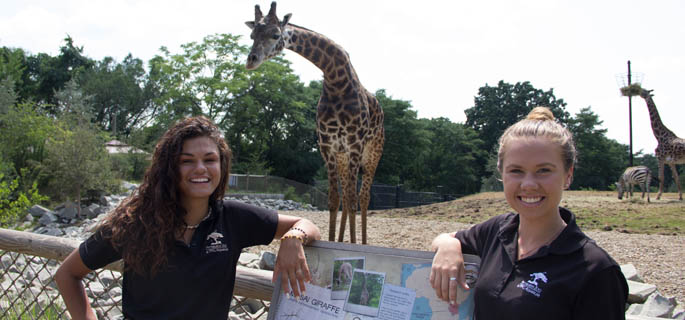 Pictured are Olivia Gradwell and Alexandra Gradwell, SAEM students and interns at the Pittsburgh Zoo. | Photo by Shayna Mendez