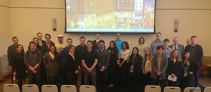 Pictured are Point Park students with accounting professionals from Schneider Downs. | Photo by Sarah Myskin