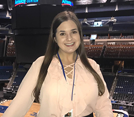 Pictured is SAEM alumna Dana Drewniak, ticket sales representative for the Orlando Magic. | Photo by Rachel Maddox