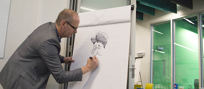 Rob Rogers from the Pittsburgh Post-Gazette sketches a political cartoon at the Center for Media Innovation. Photo | Shayna Mendez