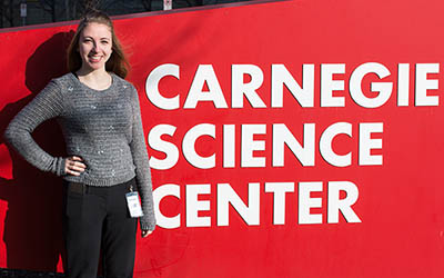 Pictured is public relations and advertising student Kariann Mano at the Carnegie Science Center. | Photo by Victoria A. Mikula