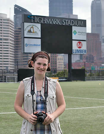 Pictured is photography major Liz Berie at Highmark Stadium. Photo | Victoria A. Mikula