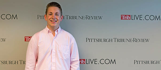 Pictured is School of Communication student Phillip Poupore at the Pittsburgh Tribune-Review. Photo | Victoria A. Mikula