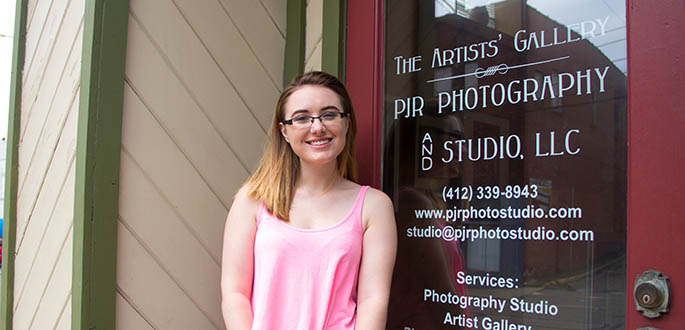 Pictured is photography major Rebecca Painter, an intern at PJR Photography and Artists' Gallery. Photo | Shayna Mendez