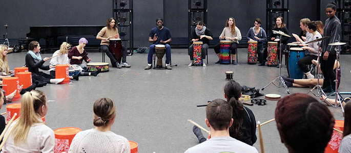 Students attend an African Drumming Class during World Cultures Dance Week. Photo | Ryan Loew