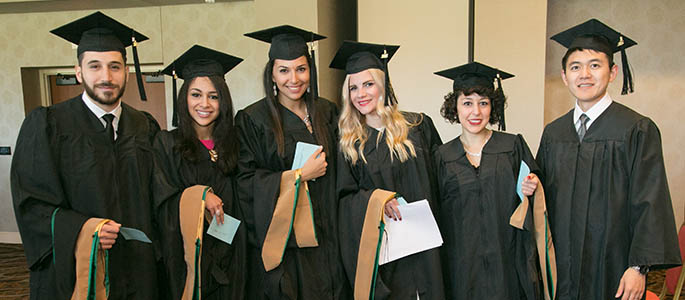 Pictured are students at the 2015 master's degree Hooding and Degree Conferral ceremony. Photo | John Altdorfer