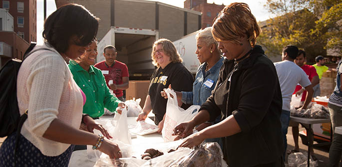 Students in the Ph.D. in community engagement program partnered with the Pittsburgh Food Bank. Photo | Sarah Collins