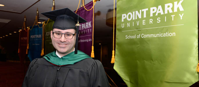 Pictured is M.A. in communication technology graduate Brian Miller. | Photo by Chris Rolinson