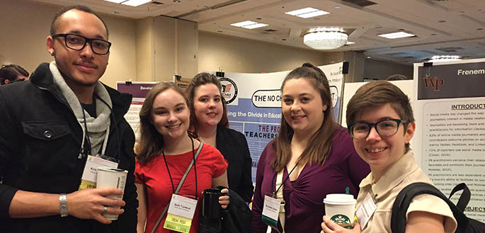 Kris Chandler, Beth Turnbull, Sarah Martin, Nicolette Jones and Autumn Barszczowski attend the final poster session at the National Regional Honors Conference in Pittsburgh. Submitted photo