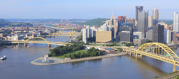 Photo of Downtown Pittsburgh and Point State Park, showing the city skyline and the three rivers. iStock photo.