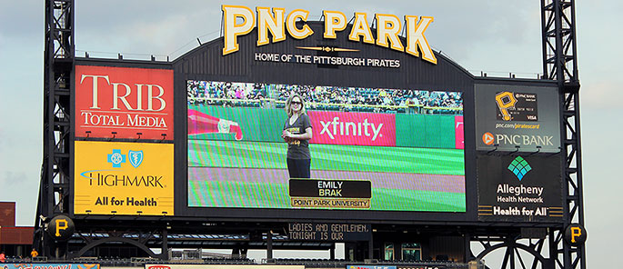 Point Park University student Emily Brak throws out the first pitch at PNC Park on April 17, 2015.