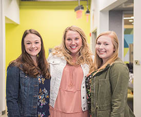 Lauren Joseph, Maggie McCauley and Caite Miller in the Center for Media Innovation. Photo | Nick Koehler
