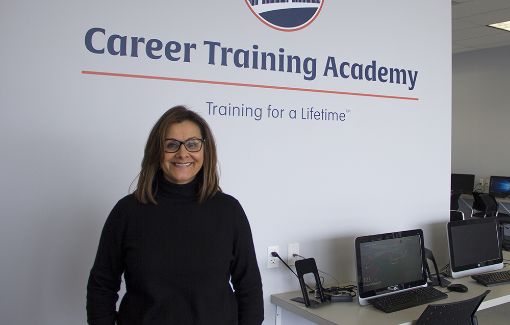 Pictured is alumna Kimberly Rassau, Ed.D., president and CEO of Career Training Academy