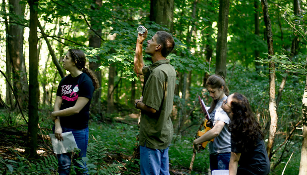 Matthew Opdyke and his botany students assess forest health and carbon sequestration at Lowries Run Slopes in Pittsburgh. | Photo by Vania Arthur