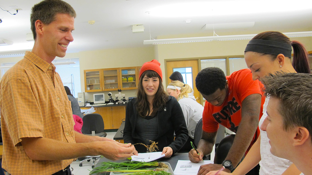 Pictured is Professor Matthew Opdyke, Ph.D., teaching a botany class. Photo by Amanda Dabbs