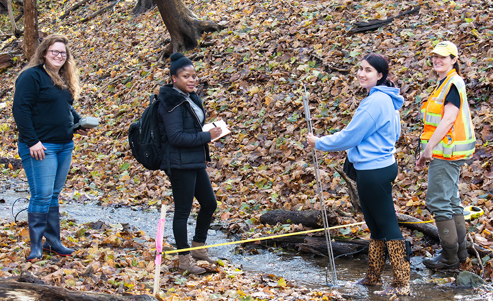 Pictured are Master of Science students measuring stream flow at Schenley Park. Photo by Brandy Richey