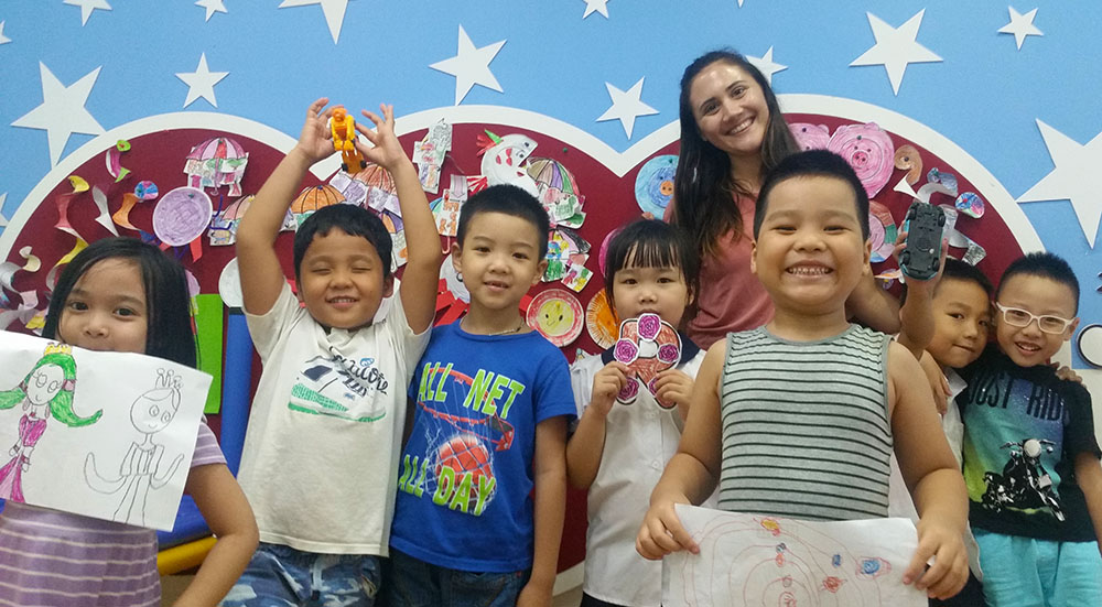 Pictured is global cultural studies alumna with Kindergarten students in Hanoi, Vietnam. Photo submitted by Roux.