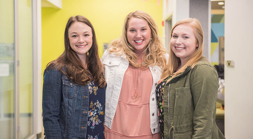 Alumnae Lauren Joseph, Maggie McCauley and Caite Miller in the Center for Media Innovation. Photo | Nick Koehler