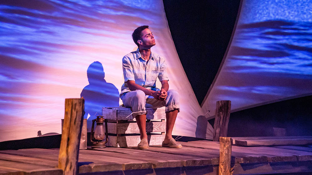 Gabriel Florentino as Manolin in the world premiere stage adaptation of The Old Man and the Sea . Photo | John Altdorfer