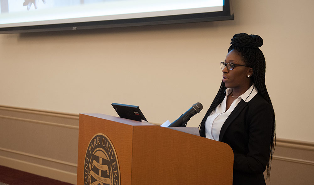 Pictured is a graduate student presenting research at Point Park University. Photo by Sarah Collins