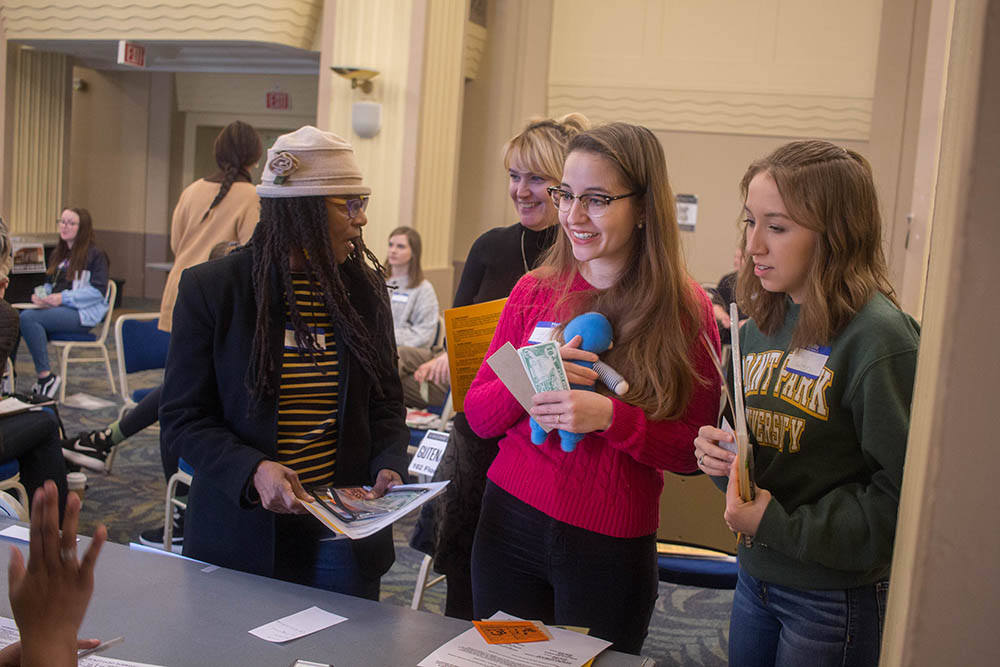 Students met with community resource providers during the poverty simulation event on campus.