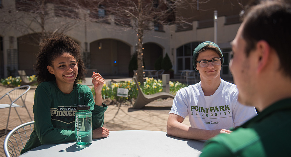 Pictured are Point Park students in Village Park. Photo by Nick Koehler.