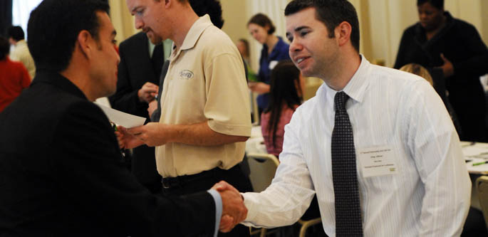 A Point Park student and a prospective student shake hands at the 2010 Internship and Job Fair. | Photo by Christopher Rolinson